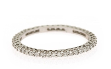 A diamond eternity ring set with numerous brilliant-cut diamonds totalling app. 0.45 ct., mounted in 18k white gold. Size 51.
