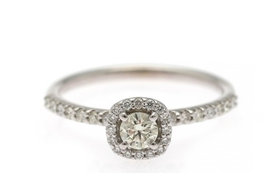 A diamond ring set with a brilliant-cut diamond flanked by numerous diamonds weighing a total of app. 0.50 ct., mounted in 14k white gold. Size 52.