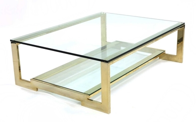 A gold-plated and glass coffee table