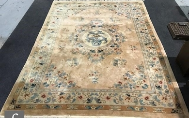 A large 20th Century Chinese carpet, all over floral decorat...