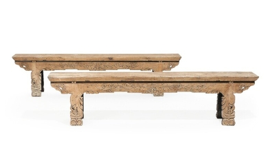 NOT SOLD. A pair of Chinese hardwood benches with remnants of black paint, richly carved...