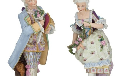 A pair of cold painted biscuit sculptures of...
