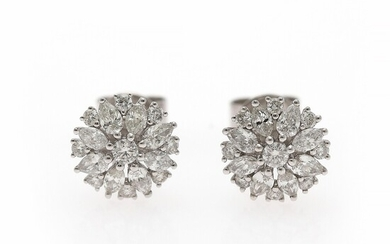 A pair of diamond ear studs each set with numerous diamonds weighing a total of app. 0.92 ct., mounted in 18k white gold. Diam. app. 9.5 mm. (2)