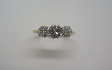 A yellow gold three stone diamond ring tests to approx 18ct,...