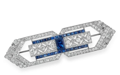 AN ART DECO DIAMOND AND SAPPHIRE BROOCH set with step