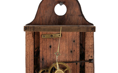 ANTIQUE MOVEMENT. Wooden case and gear train on wooden rollers.