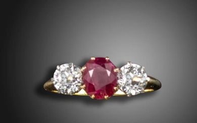 An early 20th century ruby and diamond three stone ring, the oval-shaped ruby weighs 1.82cts, flanked with old circular-cut diamonds in platinum and gold, size P Accompanied by report number 79186-35 dated 9 November 2018 from GCS stating that the...