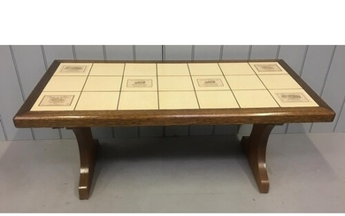 An unusual vintage tiled coffee table, from the 1980's. The ...