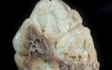 Arte Cinese A celadon and grey jade carving of a