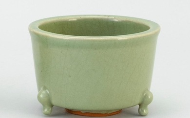 """CHINESE CELADON STONEWARE CENSER Cylindrical, with a tripod base. Diameter 5""""."""
