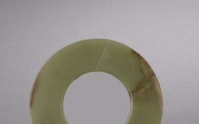 HUMAN TYPE DISC made of celadon jade-nephrite with rust veins.