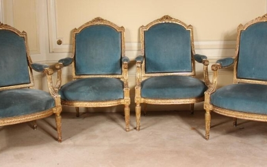 Louis XVI style straight-backed lounge furniture in carved gilded wood with garlands of flowers, comprising a two-seater sofa and four armchairs.