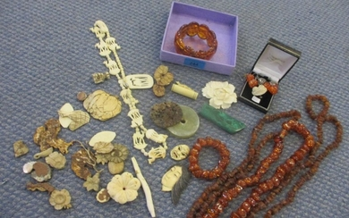 Mixed stone and bone items to include early 20th Century ivo...