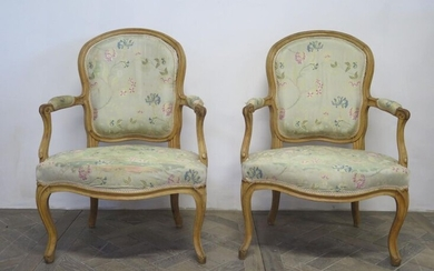 Pair of armchairs in moulded and carved wood, formerly lacquered.