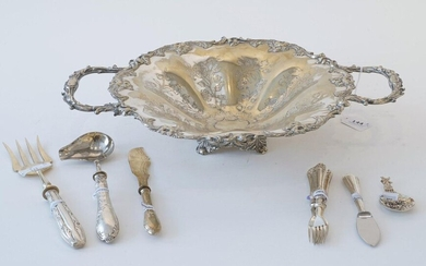 Silver-plated dish, with floral decoration, 19th/20th century, one handle is loose, diam. 31 cm + Silver with steel oyster knife, 800 + Silver meat fork, 800 + Silver gravy spoon, below the legal amount + 3 meat forks + Butter knife + Silver tea tumb...