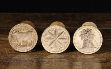 Three Carved Sycamore Butter Stamps. The round decorative moulds carved with a star & daisy heads, a