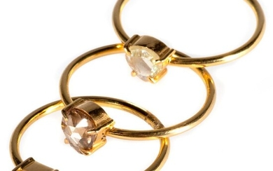Trio of diamond, 18k gold stackable rings