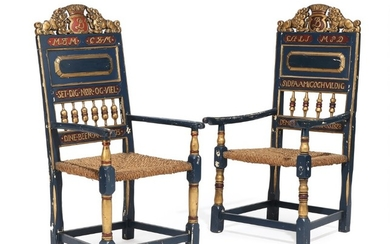 Two 19th century painted armchairs carved with lions and owner's initials, woven seat. Lars Hugger style. (2)