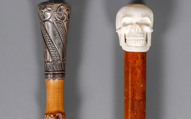 Two canes with handles in silver and bone and rods in bamboo and wood, first half of the 20th Century.