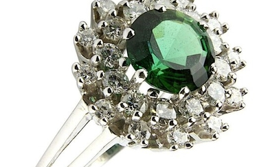 White gold ring with tourmaline and diamonds, German circa 1970, white gold 18 ct rhodium-plated, not hallmarked, tested, flower-shaped ring head with central green tourmaline, ca. 2.00 ct, surrounded by 24 brilliant-cut diamonds, ca. 0.72 ct, fine...