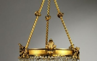 A BRASS AND CUT GLASS THREE-TIER CEILING LIGHT. 22ins
