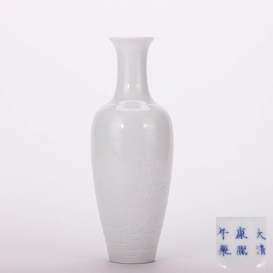A Chinese White Glaze Dragon Pattern Relief Porcelain