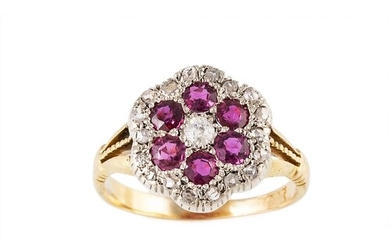A DIAMOND AND RUBY CLUSTER RING, set with circular diamonds ...