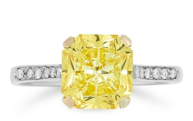 A FANCY VIVID YELLOW DIAMOND RING set with a cut