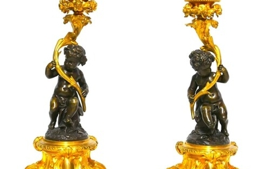 A FINE AND IMPRESSIVE PAIR OF 19TH CENTURY GILT AND PATINATE...