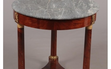 A French Empire marble top mahogany centre table of circular...