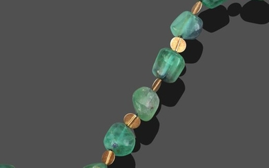 A Green Tourmaline Necklace, by Charmian Ottaway, irregular shaped green...