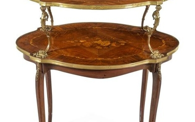 A Louis XV/XVI Transitional Style Gilt Bronze Mounted