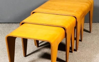 A Nest of Three Bent Beech Plywood Occasional Tables,...