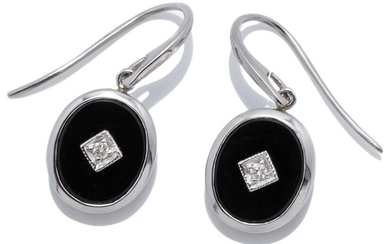 A PAIR OF DECO STYLE ONYX AND DIAMOND EARRINGS; each a 9ct white gold framed oval onyx plaque centring a round brilliant cut diamond...