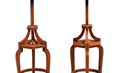 A PAIR OF GEORGE III MAHOGANY TRIPOD STANDS