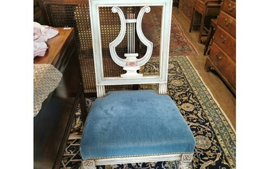 A PAIR OF PAINTED AND DISTRESSED MUSIC CHAIRS With lyre form...