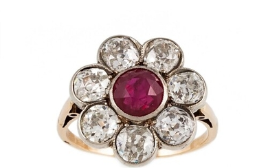 A RUBY AND DIAMOND CLUSTER RING, the circular cut ruby to a ...