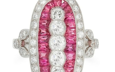A RUBY AND DIAMOND RING in oval design, set with