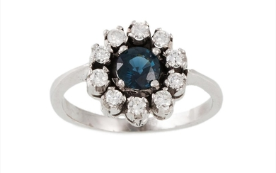 A SAPPHIRE AND DIAMOND CLUSTER RING, the circular sapphire t...