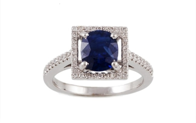 A SAPPHIRE AND DIAMOND FANCY CLUSTER RING, with one oval cut...