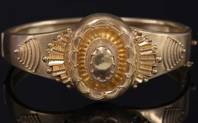 A Victorian Etruscan Revival gold bangle, c.1870