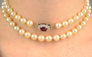 A cultured pearl single-strand necklace, with ruby and diamond cluster clasp.