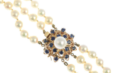 A cultured pearl three-row necklace, with sapphire and cultured pearl cluster clasp.