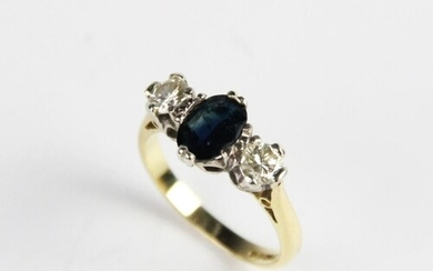 A diamond and sapphire three-stone ring, the central oval mi...
