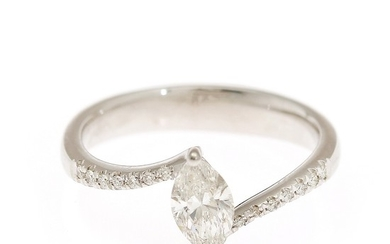A diamond ring set with a marquise-cut diamond flanked by numerous brilliant-cut diamonds, mounted in 14k white gold. Size 53.