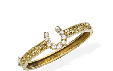 A gold and diamond bangle