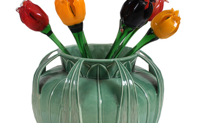 A modern green glazed jar with colored glass tulip flower