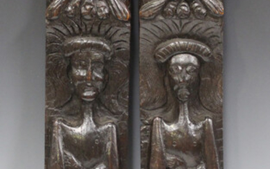 A pair of 19th century carved oak wall plaques, both decorated in heavy relief with figures and flow