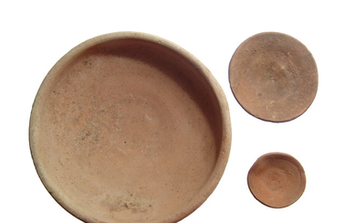 A pair of Egyptian offering dishes and a Roman bowl