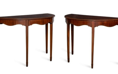 A pair of inlaid mahogany demilune side tables